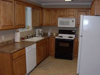 Complete kitchen with dishwasher,microwave.and coffee pot