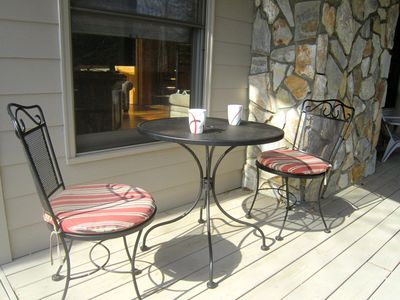 Enjoy your morning coffee at the cafe table on the covered side deck.