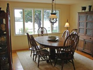 Orleans house photo - Bright dining room with water views and door leading to terrace