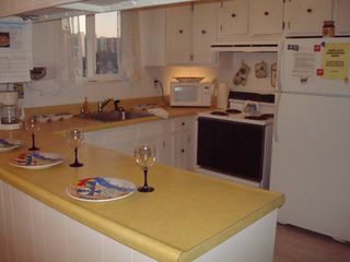 Vacation Homes in Ocean City condo photo - Bright and sunny kitchen fully equipped