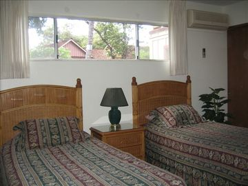 Guest bedroom with 2 long twin beds