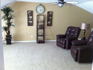 Camdenton condo photo - Reading and game room in loft with a beautiful floor to ceiling view of the lake