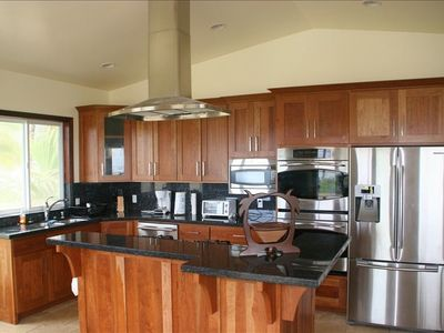 Custom kitchen that has 180 degree view of ocean. Professional appliances.