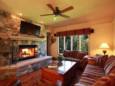 Living Room: Stone, wood-burning fireplace, 42' HDTV, big mountain views