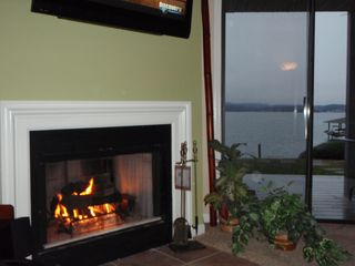 Moneta condo photo - Nice cozy fire with a lake side view on a winter evening (gas burning fireplace)