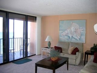 Madeira Beach condo photo - Living room opens on to balcony