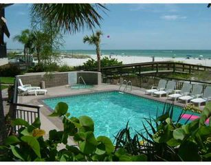 St Pete Beach condo photo - Pool with tropical landscape separates property from beautiful St Pete Beach.