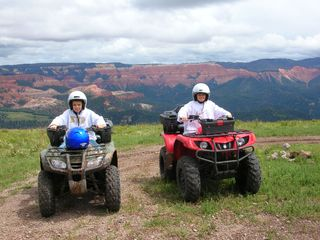 Brian Head condo photo - Summer fun! ATVs with Cedar Breaks as a back drop