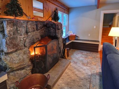 Cozy up by that large stone fireplace!