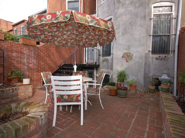 Rear patio offers a secluded outdoor space in the heart of the city