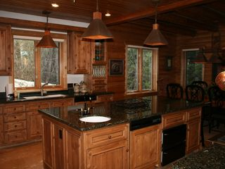 Sundance cabin photo - Kitchen. 2 sinks, 2 warming drawers, convection microwave, trash compactor.