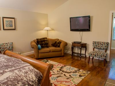 Austin house rental - Master bedroom with large wall-mounted flat screen TV, modern decor