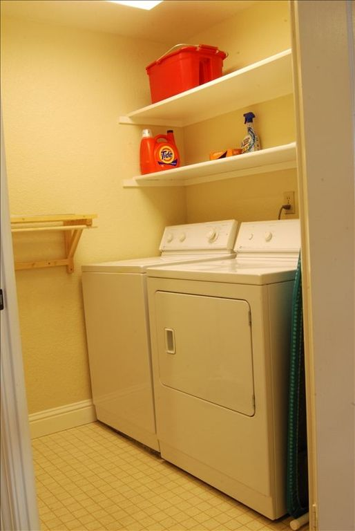 Large laundry room with full size washer - dryer, and plenty of space to work.