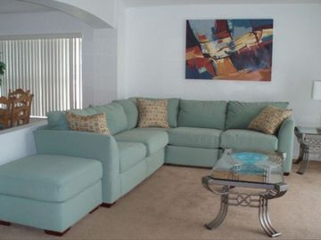 Lounge with Wi-Fi, cable TV, DVD and pool access.