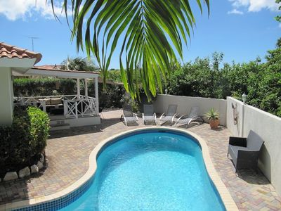 Tropical garden with palm trees, large swimming pool (9 x 3.5 m), covered terrac