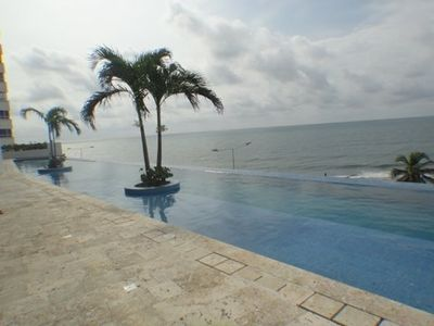 this is a photo of the infinity pool overlooking the beach.