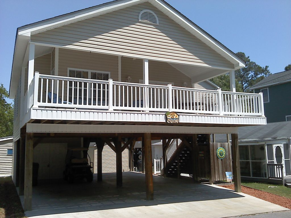 Raised house with golf cart great rates for vrbo for Elevated beach house