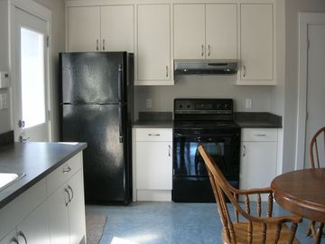 Victoria house rental - A view of the kitchen, showing separate entrance on left