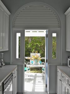 View through the kitchen to one of two outside dining areas.