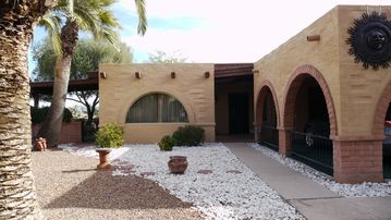 Green Valley townhome rental - Entrance and carport with dining room window