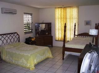 Guayama house photo - Bedroom with bathroom and kitchenette
