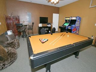 Pool table, arcade machines, TV, bar table set . . . - Windsor Hills villa vacation rental photo
