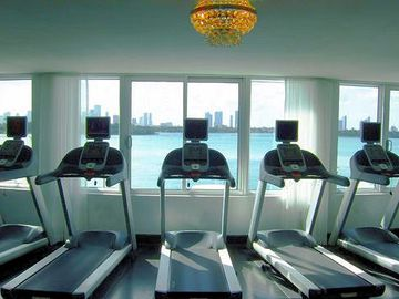 Watch the boats sail by as you look over the bay in the fitness center