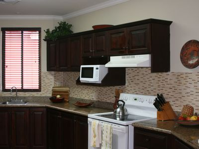 Fully applianced kitchen with granite countertops