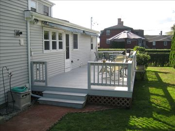Large deck with dual awnings, private backyard