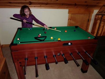 Game Table in loft. Billiards, table soccer and air hockey are fun for all!