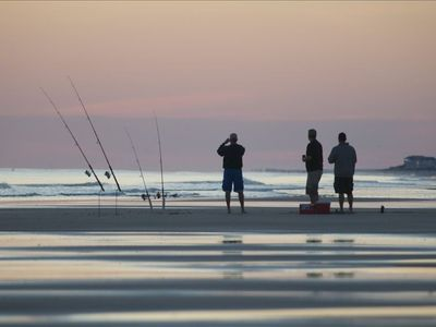Fishing on the Beach at Dusk