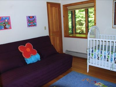 Third bedroom on first floor with futon and crib.