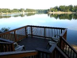 Shelton house photo - Hammersley Inlet from lower deck; there are 4 chairs and steps down to the beach