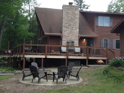 New deck, patio, & fire pit area with concrete pathway