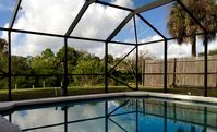 Reduced Summer Rates!  Spacious 4 BR Canal Front Home w/ Sparkling Pool & Dock!