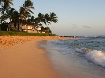 Take a morning walk along Kiahuna Plantation's sandy beach back to Beachhouse #5