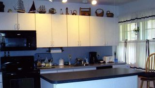 Wellfleet condo photo - Fully applianced kitchen with access to patio and gas grill