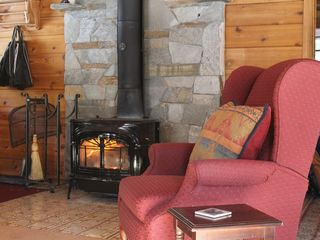 Homewood cabin photo - Comfortable recliner near the warmth of the woodstove