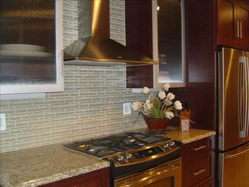 Dark cherry wood with stainless appliances and accents