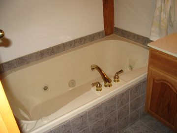 Master bedroom two person Kohler 23 inch deep Jacuzzi tub.
