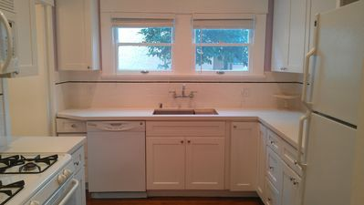 completely remodeled kitchen with caesarstone counters and all wood cabinets