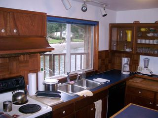 Olympia cabin photo - Full kitchen with water view. All appliances & cook ware.