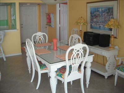 Dining room with seating for six.  Breakfast bar accommodates two.