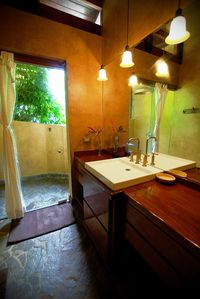 La Selva Verde's private bath has an open air shower with forest views.