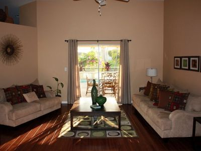 Formal Living Room and Entry with Immediate View of the Lanai and Pool