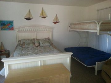 Queen bed with a large bunk
