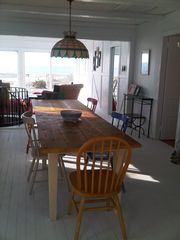 Peconic house photo - Farmhouse dining table seats 12-14 handily. Enjoy meals, inside or on the deck.