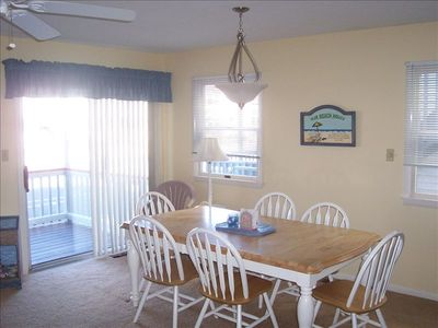 Large dining area leads to covered front porch with additional seating