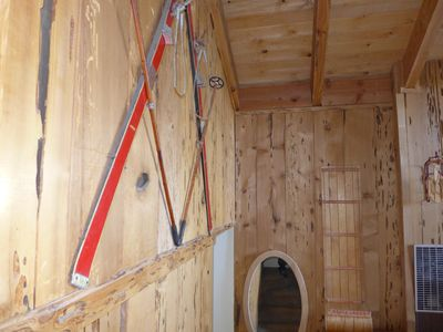 Beautiful antique skis and toboggan greeting you on the way downstairs