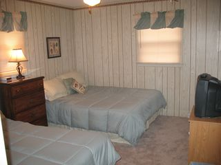 Bedrooom with 2 queen beds, TV and new carpet
